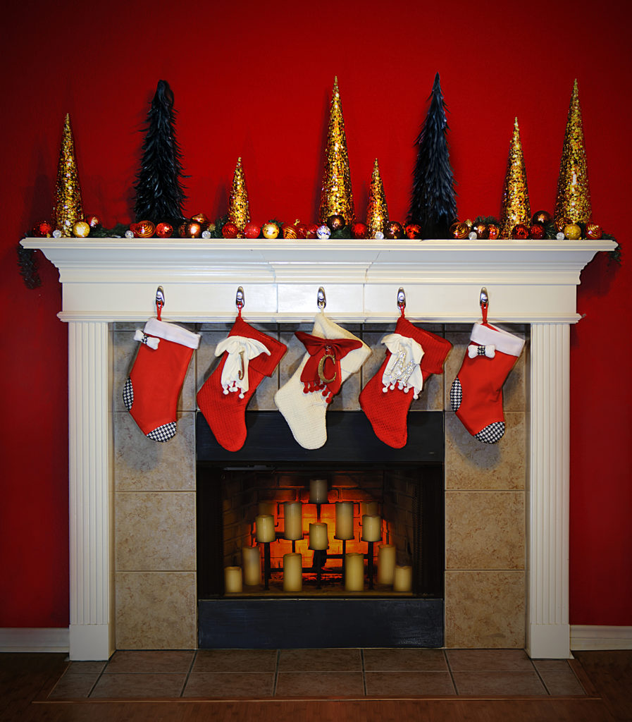 A Beautiful scene of a christmas fireplace with stockings on the mantle.